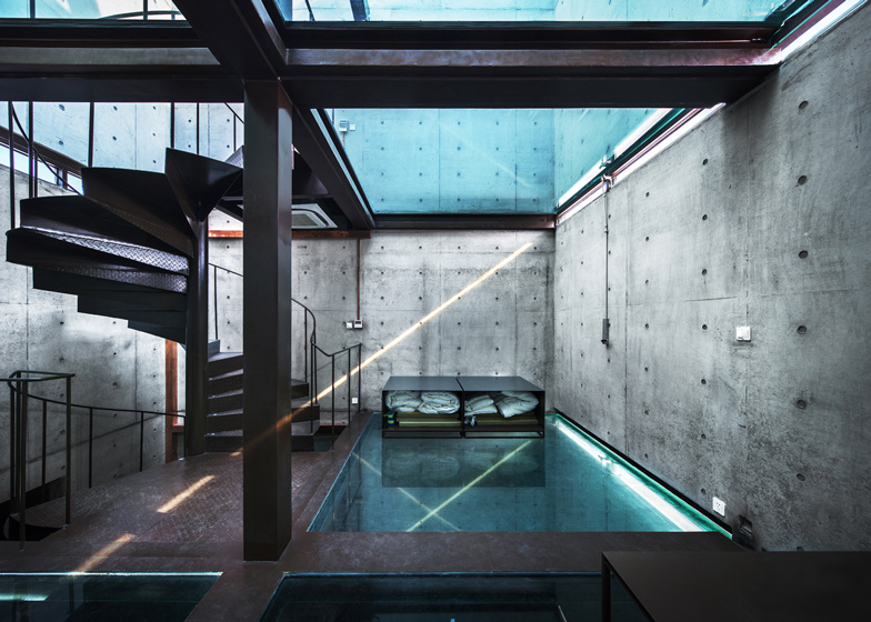 vertical glass house in shanghai by atelier