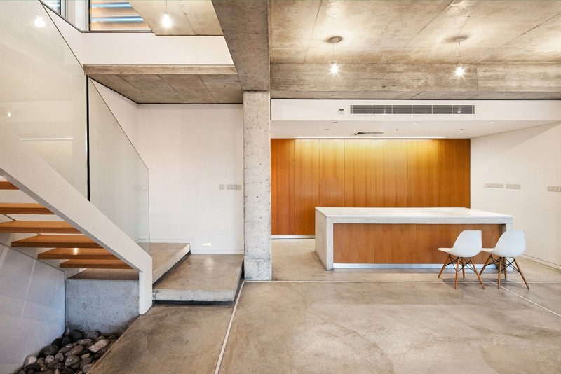 ip design: Boarded concrete and marine plywood define the George