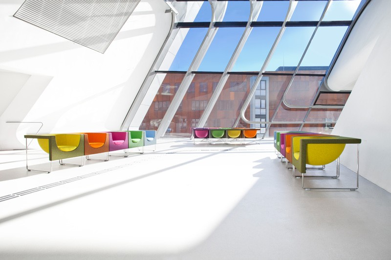 Colorful furnishing by stua brights up zaha hadid 39 s vienna for Zaha hadid vienna