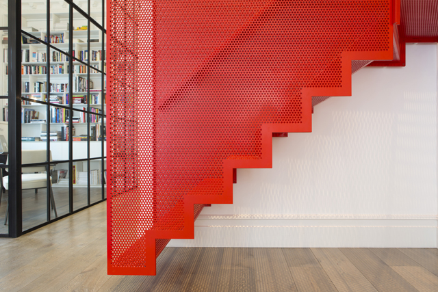 A Staircase That Hangs From The Ceiling To Create A Striking Architectural Fo