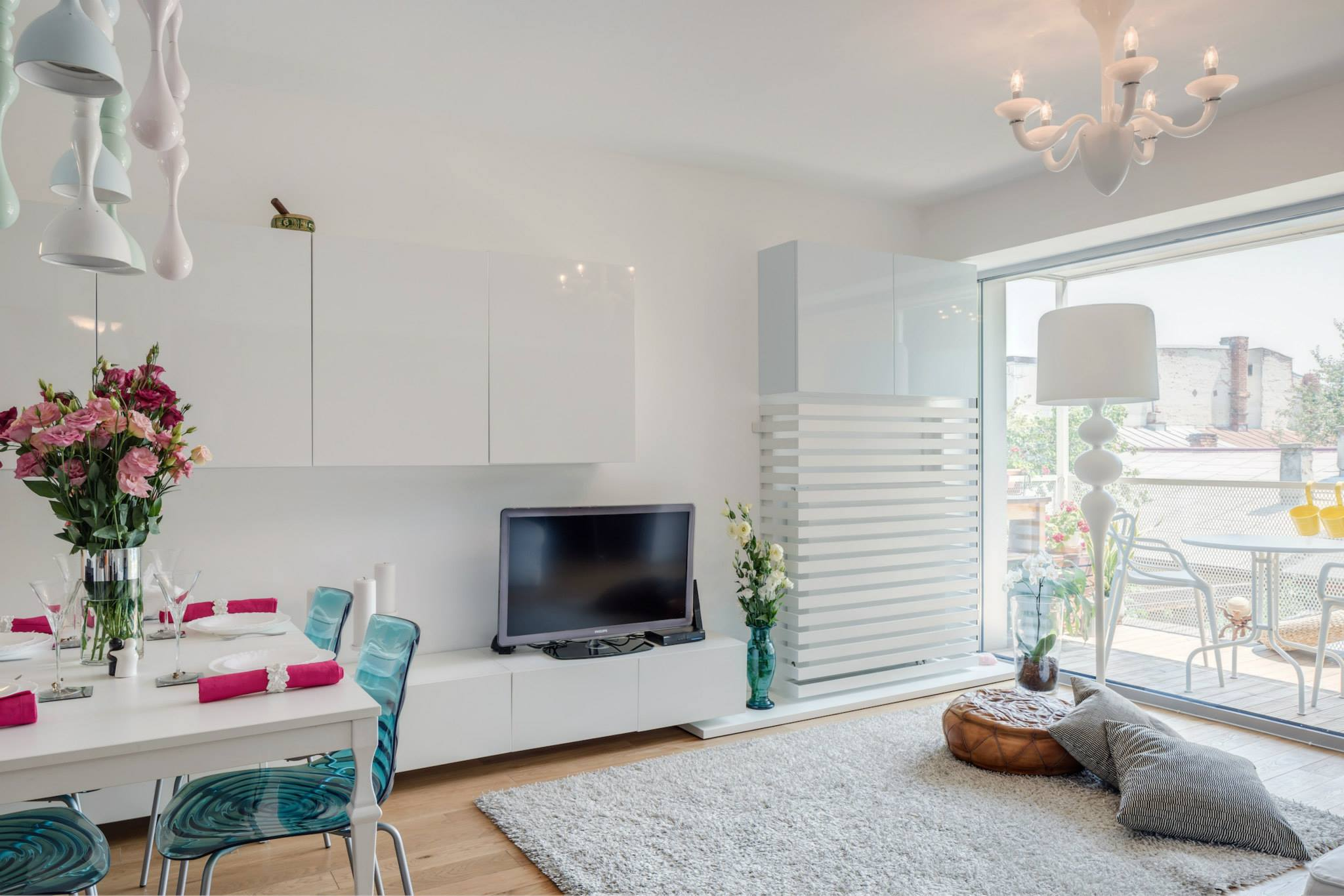 A white apartment with feminine colourful accents