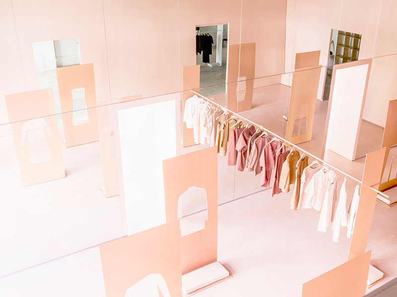 Snarkitecture for COS pop-up shop plays with concepts of reflection and monochrome