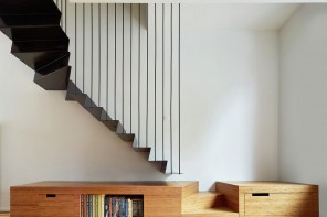 A terraced-house renovation with a suspended staircase at its center