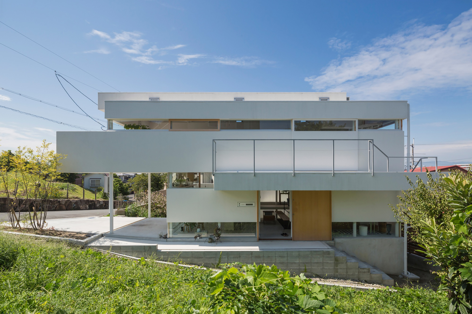 A house with a dynamic abstractness from tato architects for Dynamic house