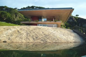 A house on a rock with oversized cantilevered roofs and extensive terraces