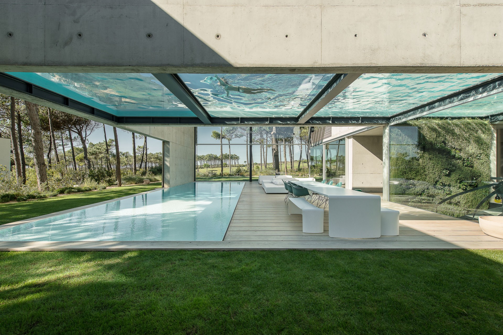 Two Exterior Pools Cross Each Other In The Wall House