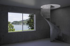 A staircase with an invisible slab that replaces a supporting pillar