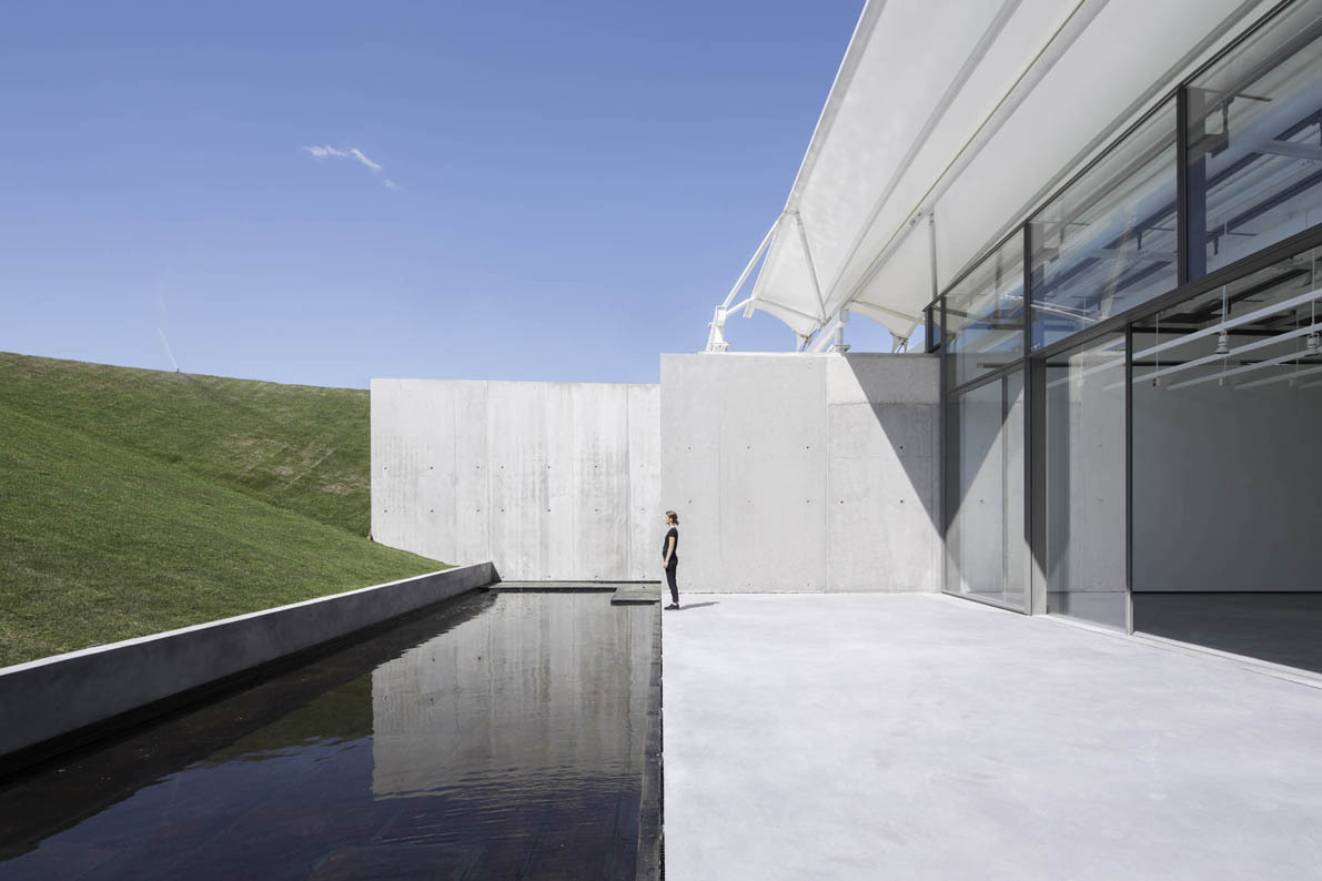 Château La Coste Art Gallery features arches that echo the graphical layout of the grapevines | Inspirationist