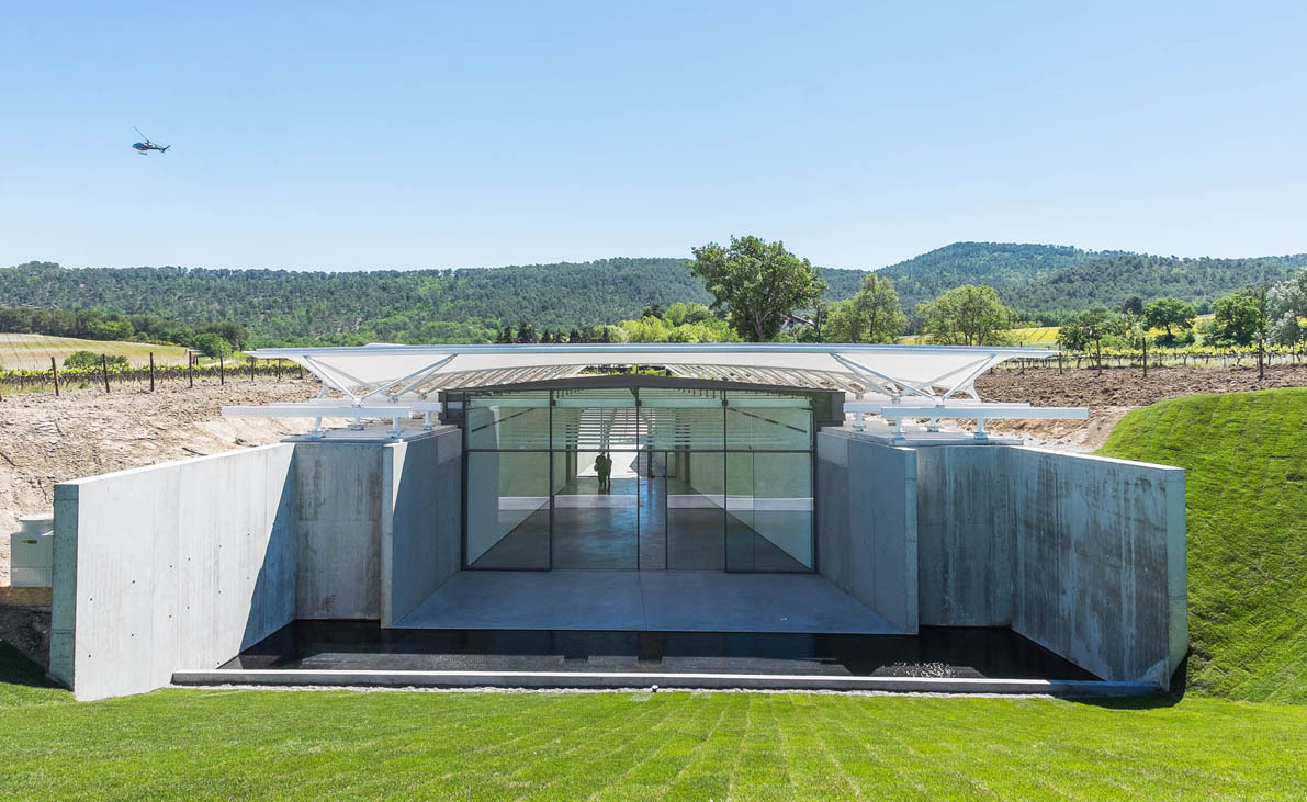 Château La Coste Art Gallery features arches that echo the graphical layout of the grapevines