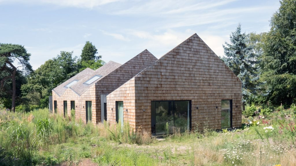 A unique undulating roof gives a dynamic shape to the five for Whats a terraced house