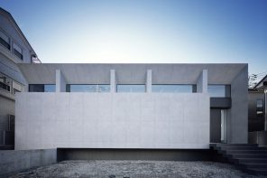 Grid: a monochrome concrete structure as a background for a large art collection