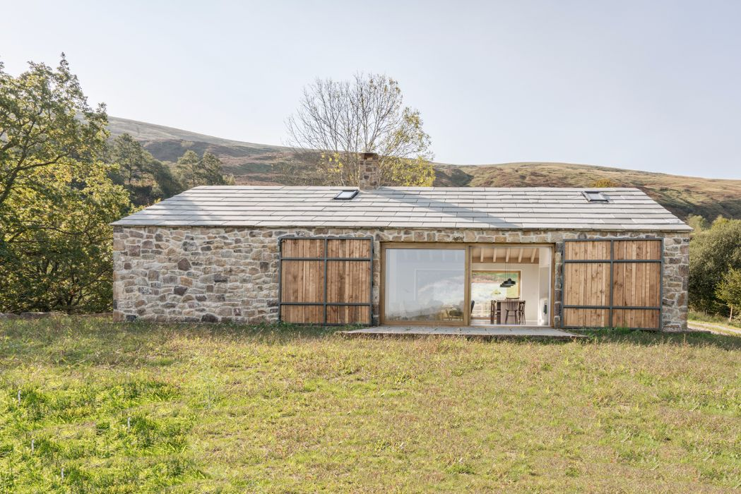 Villa Slow's rough exterior stone-walls contrast with the ...