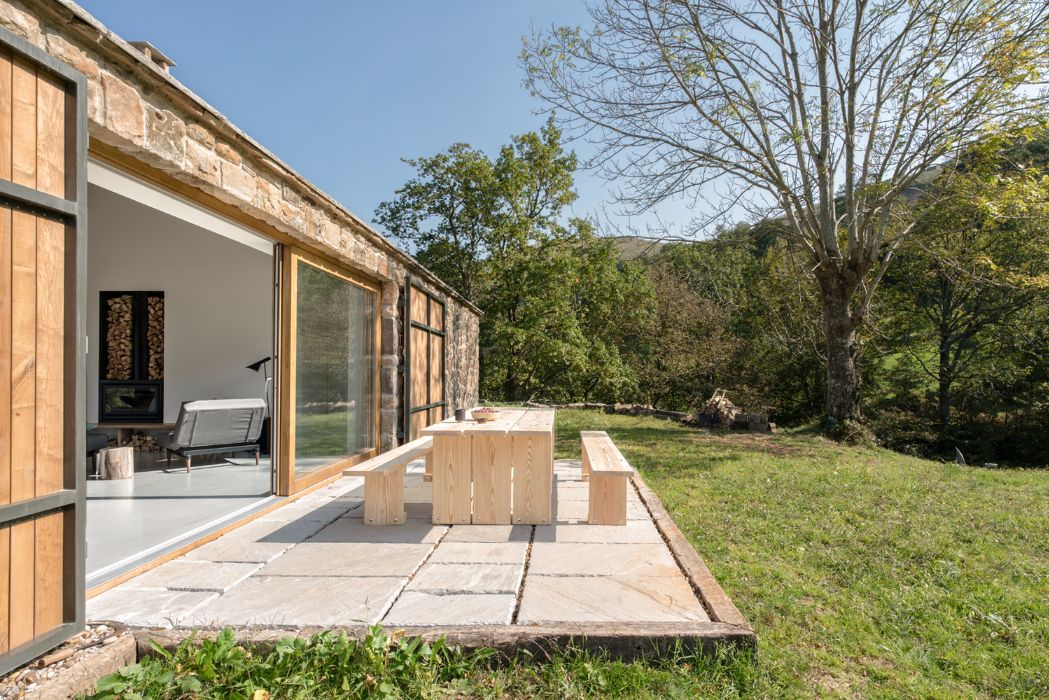 Villa Slow S Rough Exterior Stone Walls Contrast With The