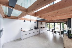 House Overveen features glass slab supported by large Douglas beams