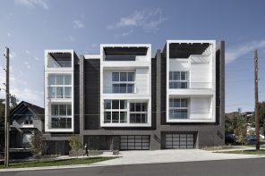 Denver Townhouse development features facades with a brick veneer, wood siding and metal screening mix