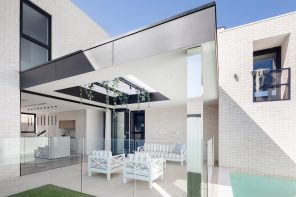 Locally sourced white bricks provide a sculptural element to a linear and contemporary home