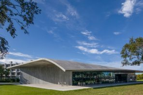 An exposed structure of glass and concrete illustrating tenets of modern architecture