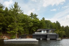 A boathouse as a series of planar elements that slide past one another