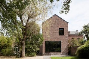 A brewery bottle house converted into a single-family home