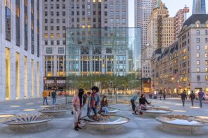 Apple Fifth Avenue features seamless curved seating surfaces that provide a reflected perspective of the city's architecture