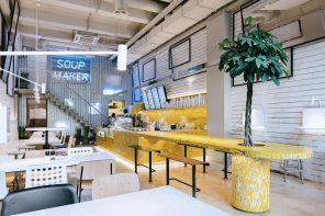SoupMaker Café features bright yellow plywood bar finished in an old Japanese technique