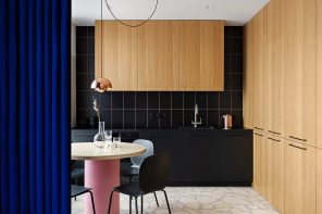 Kyiv apartment features intense cobalt curtains as zoning elements